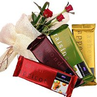 Diwali Flowers Delivery in Hyderabad including 4 Cadbury Temptation Chocolates With 3 Red Roses