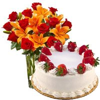 Place Online Order to Send New Year Gifts to Vijayawda having 8 Orange Lily 12 Roses Vase 1 Kg Strawberry Cake 5 Star Bakery