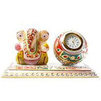 Clock in Marble with Ganesh consisting Diwali Gifts to Hyderabad Same Day