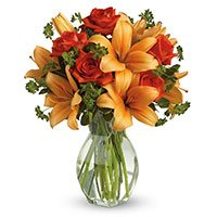 Same Day New Year Flowers to Hyderabad consisting Orange Lily Red Roses in Vase 12 Flowers
