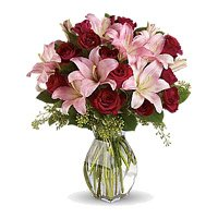 Best Flowers to Hyderabad on New Year send to 3 Pink Lily 12 Red Roses in Vase Hyderabad