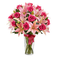 New Year Flowers in Hyderabad. 4 Pink Lily 15 Pink Rose Vase