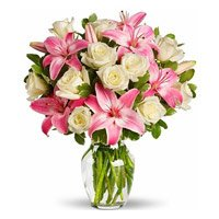 New Year Flowers Delivery in Secunderabad delivers Pink Lily White Rose in Vase 15 Flowers to Hyderabad