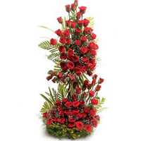 Online Christmas Flowers Delivery in Hyderabad consist of Red Roses Tall Arrangement 100 Flowers