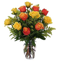Send Yellow Orange Roses Vase 12 Flowers in Hyderabad. Diwali Flowers to Hyderabad